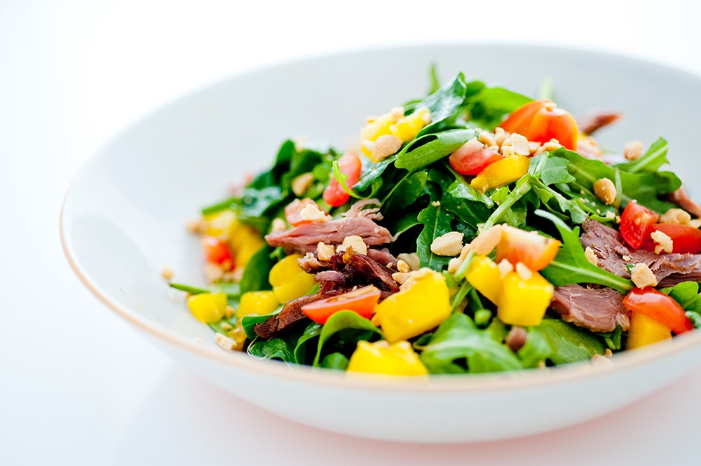 Duck-and-Mango-Salad-with-wild-rocket,-crushed-peanuts,-citrus-and-honey-dressing